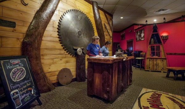 Recalling Old Town's long-time affiliation with log drives and lumber, the lobby of the BoomHouse Restaurant on Main Street incorporates a massive rotary saw blade and the matching halves of a curved tree split by Tom Gasaway.