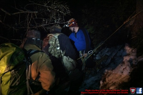 The Maine Warden Services and area firefighters rescued three Boy Scouts and a pair of Scout leaders stranded on the side of Blackcap Mountain late Saturday.