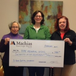 PMHSKC Capital Campaign Chair Kathy Cuthbertson (left) and Tracy Sala, PMHSKC Executive Director (center) accept a $7,500 capital campaign donation check from Machias Savings AVP and Rockland Branch Manager Judy Brogden (right)