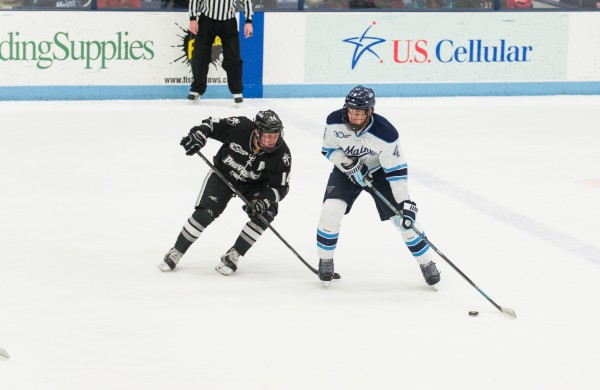 University of Maine's Jake Rutt handles the puck against Providence College's Ross Mauermann Friday night at the Alfond Arena.