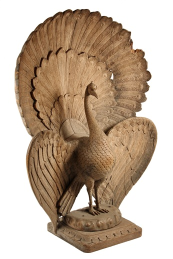 This palace-scale 19th Century Indian hardwood carving of a peacock on base wowed the auction crowd when it achieved its $8,625 sales price.