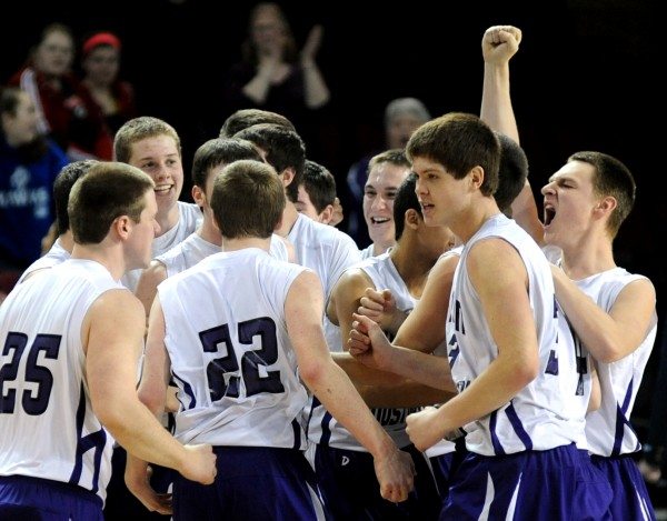Southern Aroostook players celebrate their 49-45 overtime victory over Van Buren in a Class D semifinal game at the Cross Insurance Center on Thursday afternoon.