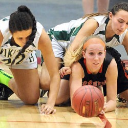 Skowhegan's Morgan Buker can only watch as the ball rolls away after Oxford Hills teammates Tiana Sugars, left and Crystal West, right teamed up to steal the ball during Friday afternoon's girls basketball playoff game at the Augusta Civic Center.