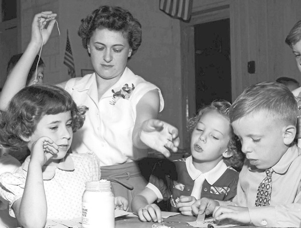 The first day of school in September 1954 was an exciting experience for children at State Street School in Brewer. Taking part in a painting class are Marie Goode (from left), teacher Helen Grotten, Faith Stubbs and Russell Woodbury.