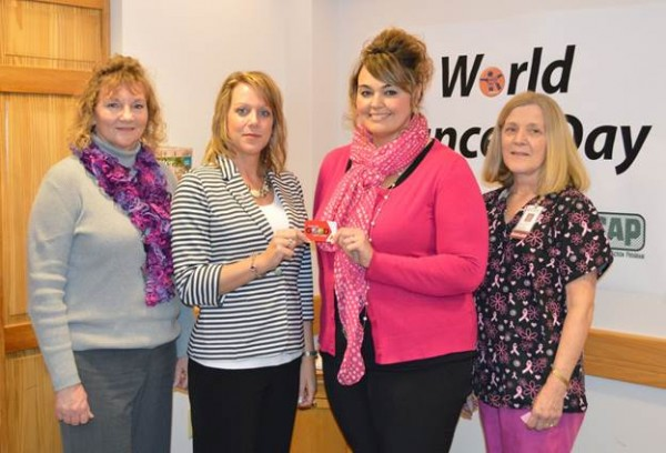 Pictured, left to right, are Jo-Ellen Kelley (ACAP), Sonya Dechene LeBoeuf (DOC), Carrie Winslow (mammography patient and breast cancer survivor), and Lana McNamee (TAMC).