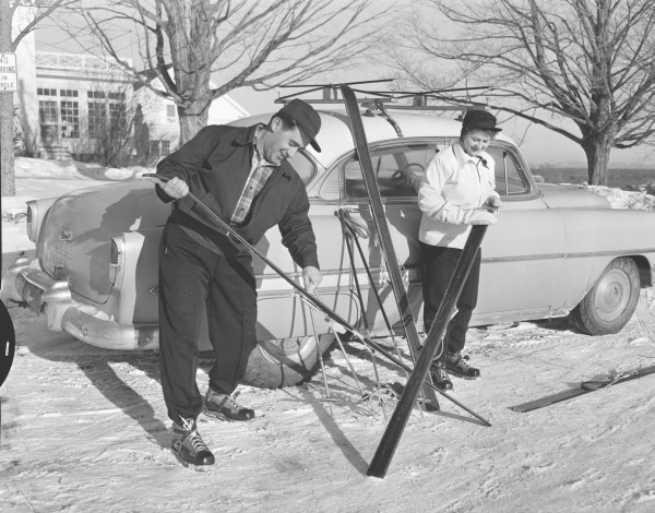 The Rev. and Mrs. Douglas W. Auld. of the Calvary Baptist Church in Brewer, wax their skis before heading out Monday, Jan. 2, 1956 at the Penobscot Valley Country Club in Orono.