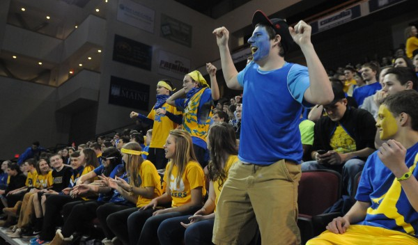 Ron Hall, a junior at Lake Region High School, cheers on his team as it prepares to take on the MDI Trojans on Friday night in the Class B girls basketball state championship at the Cross Insurance Center in Bangor.