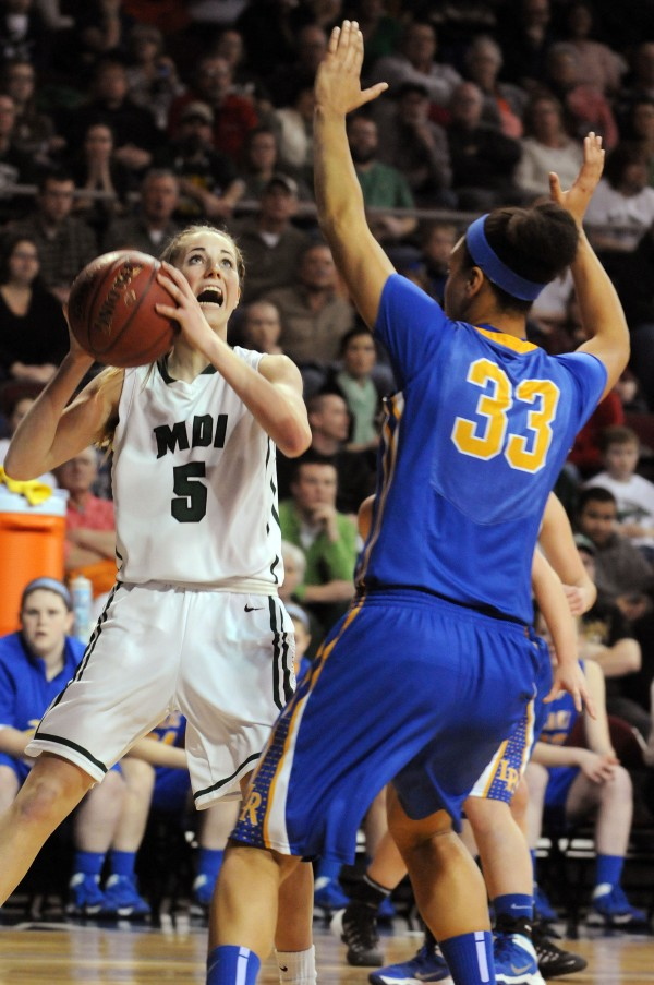 MDI's Sarah Phelps throws up a shot against Lake Region's Tiana-Jo Carter during the Class B girls state championship game on Friday night at the Cross Insurance Center in Bangor. Lake region won 56-47.