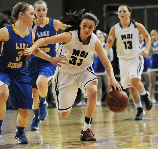 MDI's Sierra Tapley brings the ball down the court against Lake Region's Sierra Hancock during the Class B girls state championship game on Friday night at the Cross Insurance Center in Bangor. Lake region won 56-47.