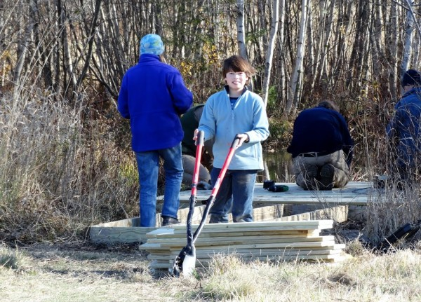 Volunteers fixing up the FPAC frog pond. Photo by Vicky Lowe