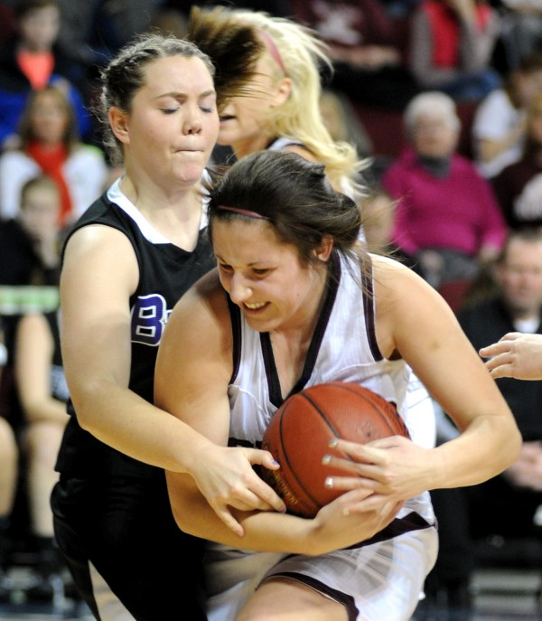 Mikalya Charters, Nokomis, keeps the rebound from John Bapst's Karrie O'Donnell in second half action of the girls Class B tournament game at the Cross Insurance Center on Saturday morning. Nokomis won the game 42-22.