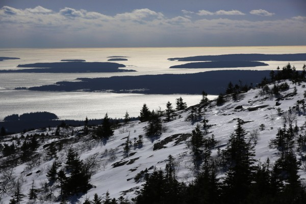 The Cranberry Islands are seen to the south of the slopes of Cadillac Mountain at Acadia National Park.