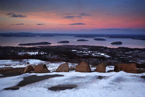 The Porcupine Islands dot Frenchman's Bay at dusk in this view from Cadillac Mountain Road at Acadia National Park.