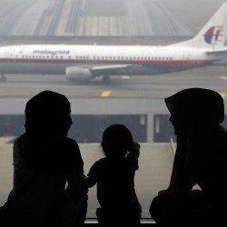 With no sign of missing Malaysia Airlines plane, search expands across land, sea
