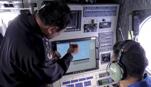 Adm. Datuk Mohd Amdan Kurish, director general of the Malaysian Maritime Enforcement Agency, looks at a radar screen while searching for a missing Malaysia Airlines plane in the South China Sea, about 100 nautical miles from Tok Bali Beach in Malaysia's Kelantan state, on Sunday.