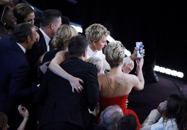 Host Ellen Degeneres takes a group picture at the 86th Academy Awards in Hollywood, California March 2, 2014.