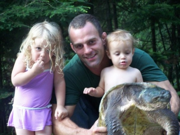 icensed wildlife rehabber Adam Farrington of Poland, Maine, and his children pose with a snapping turtle that his family are rehabilitating in 2008. The female turtle had been struck by a car and its shell had to be wired and fiberglassed. The turtle was able to lay her eggs while being cared for by the Farringtons, and they hatched. The turtle was released into the wild after her shell healed.
