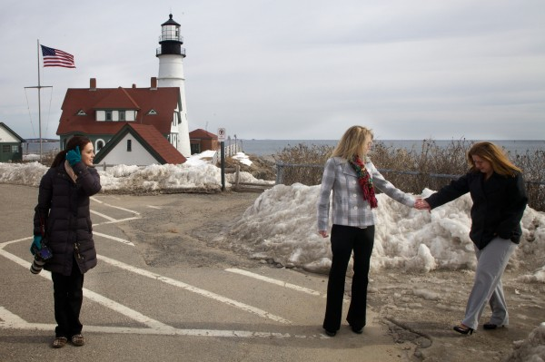Kandis Stanley (center) helps Jen Gibson over a patch of ice at Portland Headlight in Cape Elizabeth on Monday. The pair traveled from New Orleans to get married in Maine and hired Windham-based photographer Tricia Jamiol to document the event.