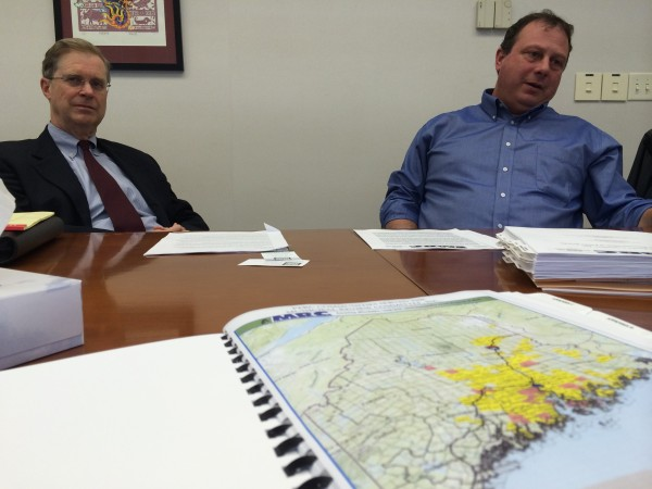 Greg Lounder (right), executive director of the Municipal Review Committee Inc., announced on Friday that the group is requesting permission from the state to open a landfill and recycling facility in Greenbush or Argyle. The Municipal Review Committee's general council, Dan McKay, sits beside Lounder. The yellow on the map of Maine indicates the 187 communities that make up Municipal Review Committee Inc. and send solid waste to the Penobscot Energy Recovery Co. waste-to-energy plant in Orrington.