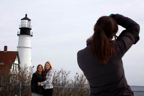 Photographer Tricia Jamiol shoots post wedding ceremony pictures of Kandis Stanley (center) and Jen Gibson at Portland Headlight in Cape Elizabeth on Monday. The pair traveled from New Orleans to get married in Maine.