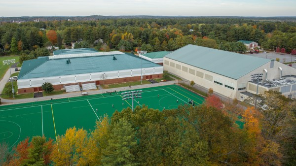 Bowdoin College is seeking to generate solar electricity with solar panels on roofs of the Farley Field House (foreground) and the Watson Arena (right).