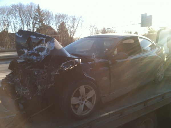 A car reported stolen from the Holiday Inn parking lot was found crashed and abandoned on I-395 Thursday morning.