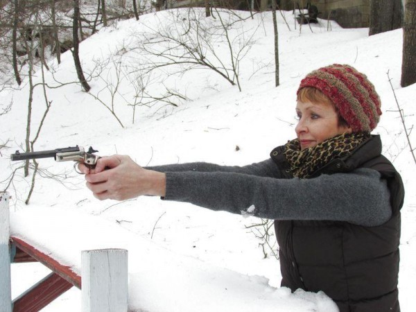 In this February 2014 file photo, Spurwink Rod and Gun Club President Tammy Walter aims a vintage .22 caliber Stevens pistol, circa 1935-1950, at the club's shooting range.