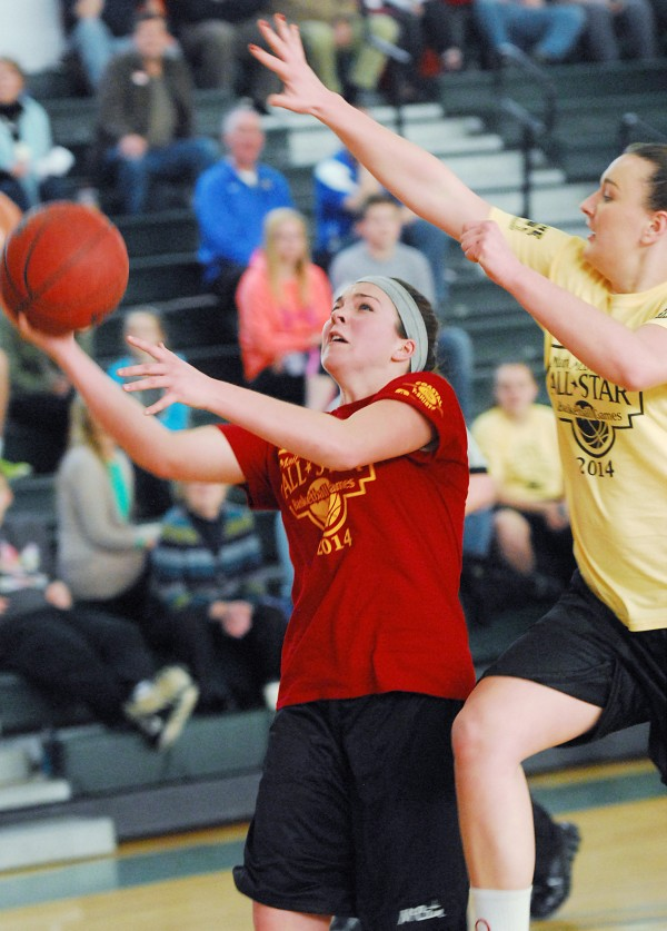 Hannah Shaw of Mount Desert Island and the East team puts up a shot against pressure from West player Olivia Shaw during the Classes A/B game during the McDonald's East-West Senior All-Star Games held at Husson University in Bangor on Saturday.