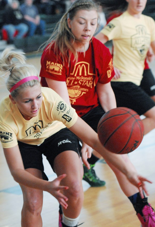 Victoria Ouellette of the West team(left) races for a loose ball a head of the East's Kelsey Mayo during the Classes A/B East contest Saturday at the McDonald's East-West Senior All-Star Games at Husson University in Bangor.