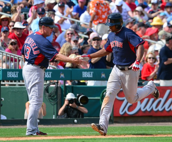 Boston Red Sox shortstop Xander Bogaerts (2) is congratulated by Red Sox third base coach Brian Butterfield (13) after hitting a home run March 5 against the St. Louis Cardinals at Roger Dean Stadium. The Cardinals defeated the Red Sox 8-6.