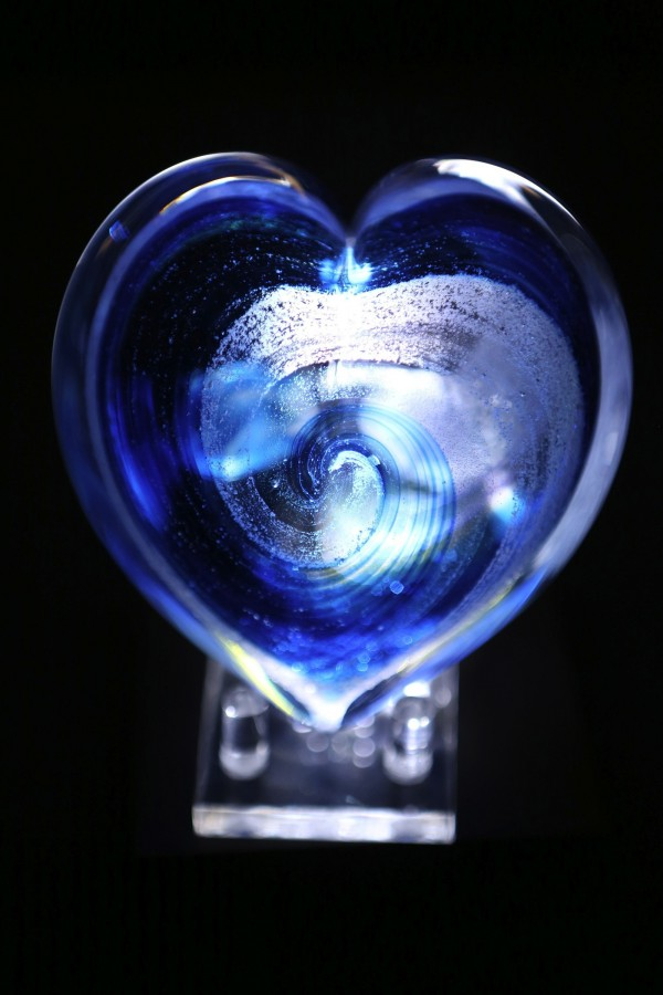 Heart-shaped glass keepsakes containing the ashes of a deceased loved one are offered by an art studio in Seattle.