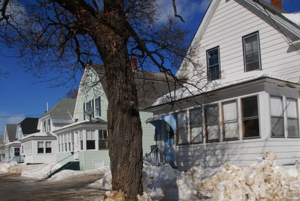 This property at 27 Katahdin Ave. (right), as seen on Monday, March 3, 2014, is among 25 tax-acquired buildings that Millinocket officials hope to sell in April.