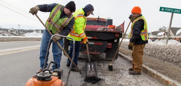 Crew leader Dave Baker (from left), Andrew Coughlin, and Eric Lunn of Falmouth's Public Works Department fill potholes Monday on U.S. Route 1.