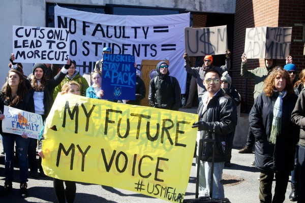 In Portland on Monday, a crowd protests proposed deep cuts at the University of Southern Maine. The cuts would eliminate four full programs and between 20-30 faculty positions.