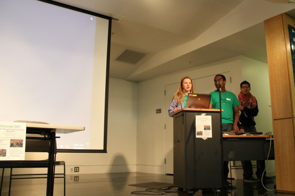 Meredith Roderka and Mohamed Nur, former campers at Seed of Peace, speak at an event where more than 50 students gathered to strategize ways to improve the education system in Maine.