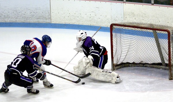 John Bapst's Joe Archambault attempts to disrupt the shot of Messalonskee's Jared Cunningham on a breakaway attempt while Crusaders goaltender Sam Lander lunges to make the save in an East Class B semifinal Saturday night at Sukee Arena in Waterville. Cunningham scored four goals in Messalonskee's 7-3 win.
