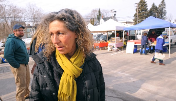 Pat Bears (right) of Orono was at the Orono Winter Farmers' Market on Saturday renewing her community-supported agriculture shares with several farms.