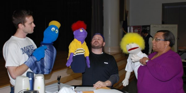 Nathan Roach (left), Matthew Madore (center) and Nancy Dymond (right) rehearse with puppets for a number from the hit-musical &quotAvenue Q.&quot The three will perform this weekend in the Bangor Rotary Club's annual show, &quotMusic Off Broadway.&quot