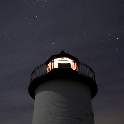 Stars surround Robinson Point Lighthouse Station on Isle au Haut during a winter evening on the island.