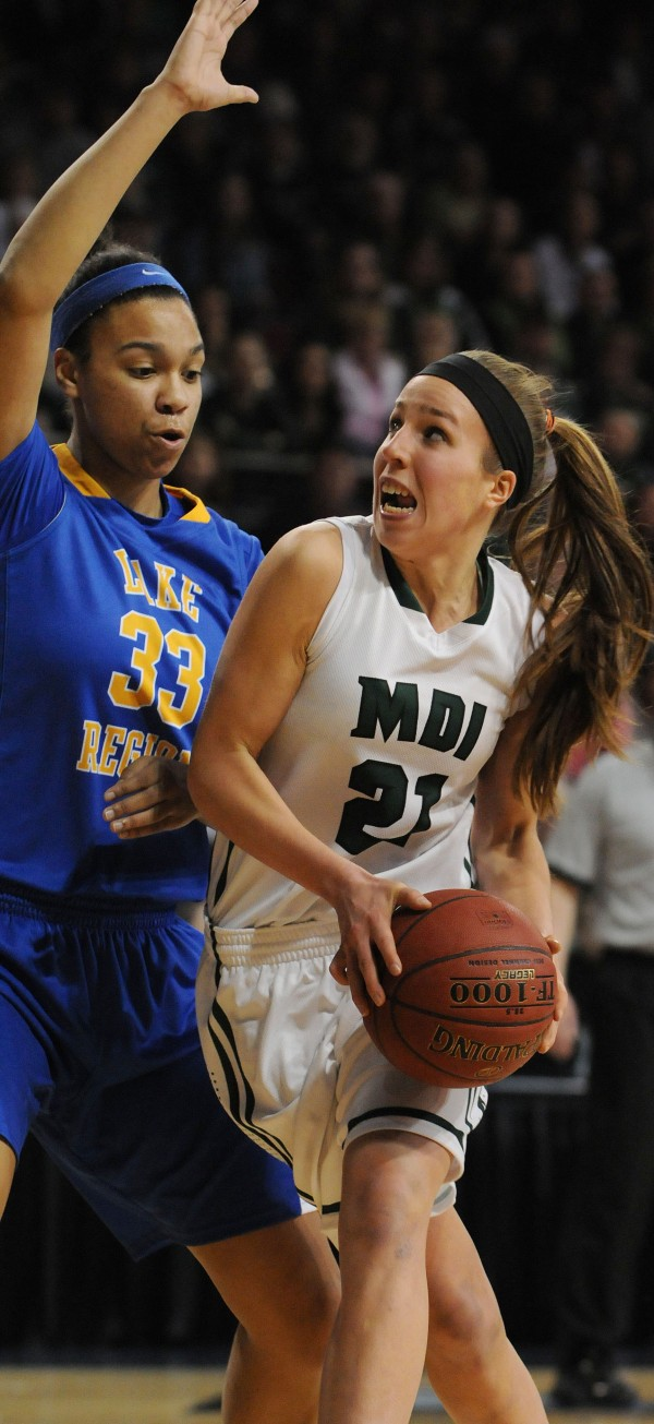Mount Desert Island's Kelsey Shaw takes the ball to the hoop against Lake Region's Tiana-Jo Carter during the Class B state final Friday night at the Cross Insurance Center in Bangor. Lake Region won 56-47.  Carter is a finalist for the Miss Maine Basketball award.