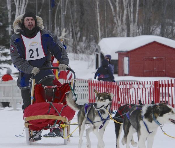 Musher Mark Patterson of Shirley comes into the finish at the Pepsi Bottling Company-Allen's Coffee Brandy Cam Am 30 Saturday morning. Patterson tool 7th place overall while his wife Ashley Paterson finished 7th in the Willard Jalbert Jr. Can Am 60-mile race.