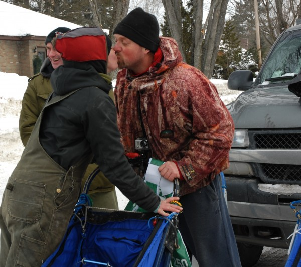 Mushing team and participants in this year's Irving Woodlands Can Am Crown 250-mile race Julie Albert and Denis Tremblay share a pre-race kiss before the Main Street start in Fort Kent on Saturday.