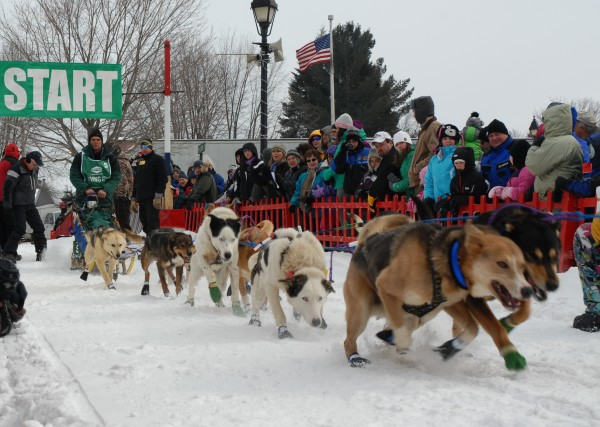 Musher Andre Longchamps of Pont-Rouge, Quebec, takes off from the start line at the Irving Woodlands Can Am Crown 250-mile race Saturday morning in Fort Kent.