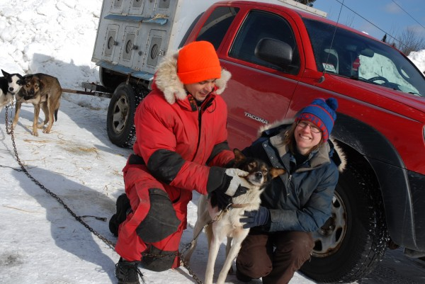 Mushers Rico and Paula Portalatin spend a few moments with their lead dog Knickers at the Can Am Crown after checking in at the Can Am Crown Sled Dog Race headquarters Friday afternoon.