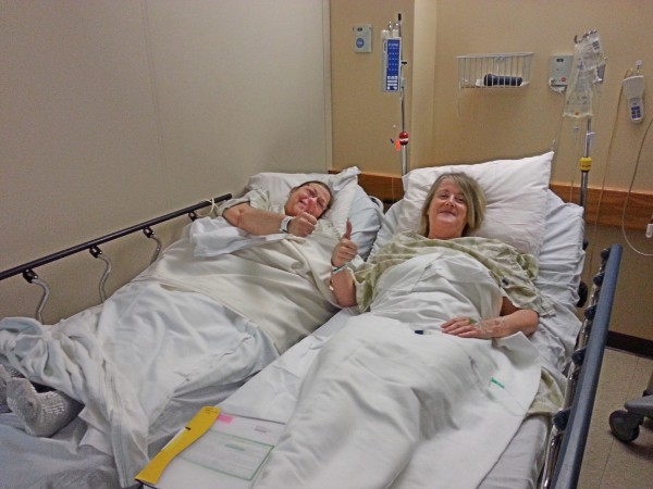 Darylen Cote (left) and Karen Keim give a pre-op thumbs up Jan. 14, when Cote received a kidney from Keim at the Maine Medical Center in Portland.