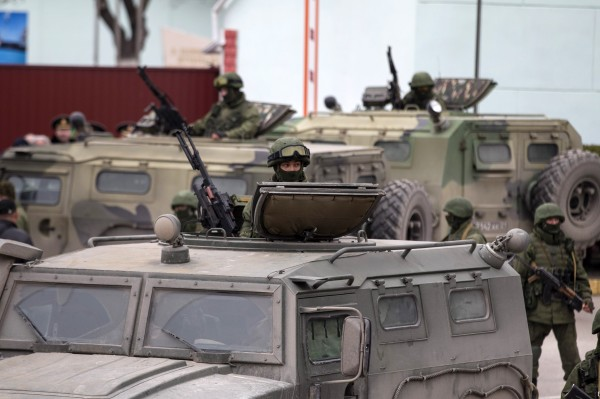 Armed servicemen stand in Russian army vehicles outside a Ukrainian border guard post in the Crimean town of Balaclava on March 1. Ukraine accused Russia on Saturday of sending thousands of extra troops to Crimea and placed its military in the area on high alert as the Black Sea peninsula appeared to slip beyond Kiev's control.