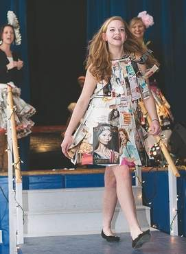 A York Middle School student sashays down the runway wearing clothes made of garbage in a recent &quotTrashion Show.&quot
