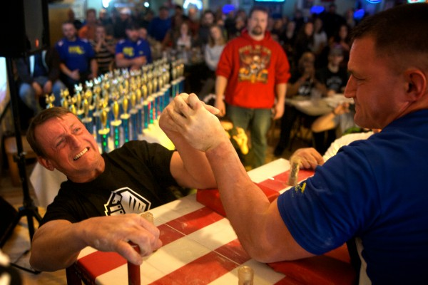 Bill Sinks of Vermont (left) pulls with all his might against Chris Burns of Massachusetts in a left hand division at the 2014 Maine State Armwrestling Championship at Thatcher's Restaurant in South Portland on Saturday afternoon.
