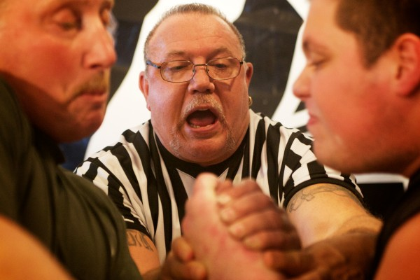 Referee Art &quotBadger&quot Drewes sets up two opponents Saturday at the  2014 Maine State Armwrestling Championship in South Portland. Drewes is a five-time world champion.