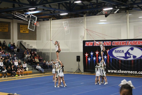 Husson University cheerleaders do a second stunt series during the New England Cheerleading & Dance Team Open Championships Saturday in East Haven, Conn.